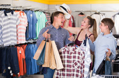 Young couple and teenager with purchases Stock Photos