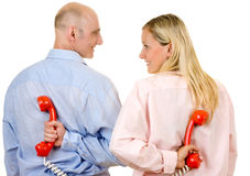 Young couple with telephones Stock Image