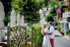 Young couple tenderly embraced in a sunny day, Amalfi coast Stock Image