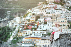 Young couple tenderly together in honeymoon in Positano, Amalfi coast, Italy Stock Photos