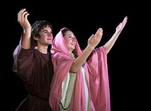 Young Couple With Their Arms Lifted in Praise Royalty Free Stock Photo