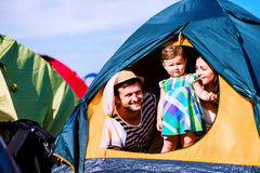 Young couple with their baby daughter in tent, summer Royalty Free Stock Photo