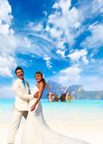 Young couple at their beach wedding Royalty Free Stock Photography