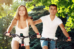 Young couple on their bikes Royalty Free Stock Image