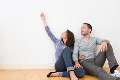 Young couple in their brand new flat / Textspace Stock Photography