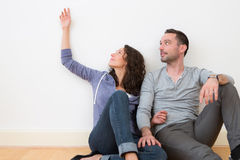 Young couple in their brand new flat / Textspace Royalty Free Stock Image