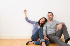 Young couple in their brand new flat / Textspace Stock Photo