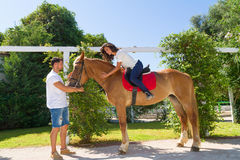 Young couple and their brown-blond horse Stock Image