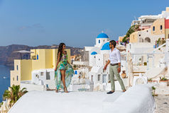Young couple on their honeymoon. In Santorini, Greece Royalty Free Stock Photography