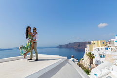Young couple on their honeymoon. In Santorini, Greece Royalty Free Stock Images