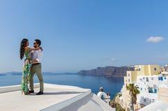 Young couple on their honeymoon. In Santorini, Greece Stock Photos