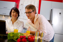Young couple in their kitchen Royalty Free Stock Images