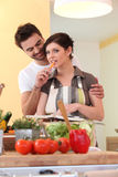 Young couple in their kitchen Royalty Free Stock Photos