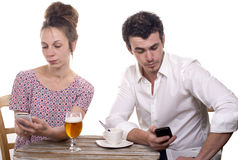 Young couple with their phones are Disgruntled Stock Photography