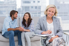 Young couple and therapist looking at the camera Stock Image