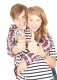 Young couple with thumb up Stock Photo