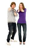 Young couple with thumbs up Stock Images