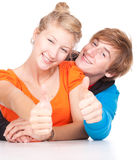 Young couple with thumbs up Stock Image