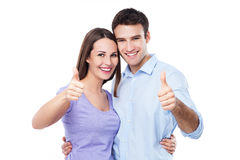 Young couple with thumbs up Stock Photos