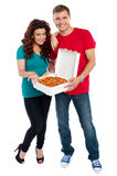 Young couple about to enjoy pizza together Royalty Free Stock Photo