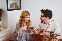 Young couple toasting with cocktail glasses at home Stock Photography