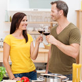 Young couple toasting each other Royalty Free Stock Photography
