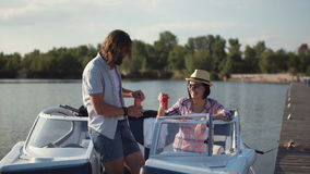 Young couple toasting each other in a motorboat stock video footage