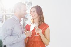 Young couple toasting glasses of champagne Stock Photos
