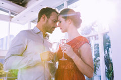 Young couple toasting glasses of champagne Stock Image