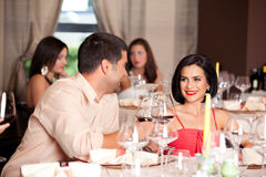 Young couple toasting restaurant table Royalty Free Stock Photo