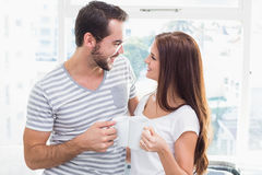 Young couple toasting their coffees Royalty Free Stock Photo