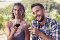 Young couple toasting in a vineyard Stock Photo