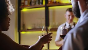 Young Couple Toasting Wine Glass In Luxury bar. Dating. Hipster and black woman on romantic dinner drinking at bar.  stock video