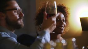 Young Couple Toasting Wine Glass In Luxury bar. Dating. Hipster and black woman on romantic dinner drinking at bar.  stock footage
