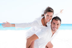 Young couple together at beach Royalty Free Stock Photo