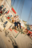 Young couple together on carousel in amusement park Stock Images