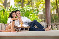 Young couple together comfort  sunbed. In beautiful green resort Stock Photo