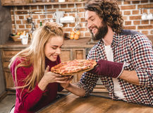 Young couple together at kitchen Royalty Free Stock Photos