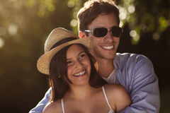 Young couple together outside in summer. Beautiful young couple holding eathother on a summer day Stock Photography