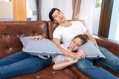 Young couple together sleeping tired. Problem, worrying, loss, serious on sofa in home at living room after work Stock Photo