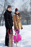 Young couple together in the snow Stock Photo