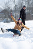 Young couple together in the snow. Winter collection: young couple in winter Royalty Free Stock Image