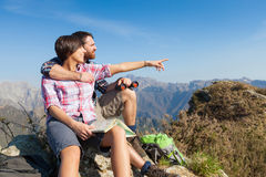Young Couple at Top of Mountain Stock Images