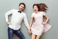 Young couple top view on grey background grimacing royalty free stock photo