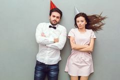 Young couple top view isolated on grey background frowing royalty free stock photography
