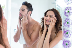 Young couple touching face in bathroom. Reflection of young couple touching face in bathroom Stock Photo