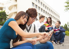 Young couple touching the smartphone. Young couple student touching the smartphone Stock Image