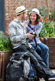 Young couple of tourist watching photographs during a break Royalty Free Stock Photo
