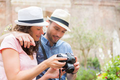 Young couple of tourist watching photographs Stock Photography