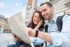 Young couple of tourists booking an activity Royalty Free Stock Photo
